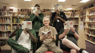 Thumb hpm thameside prison reading group with volunteer graham reading honour